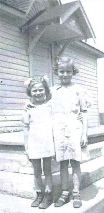 Marge andEva Stender on front steps of Kunesh School, Circa, 1940.